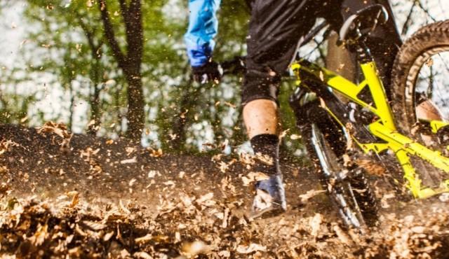 photo of mountain bike spewing mud