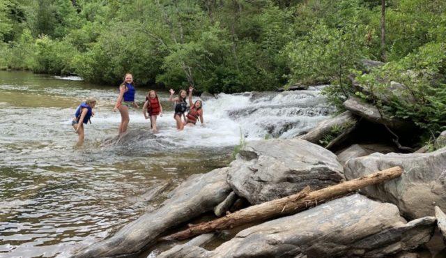photo of girls swimming at the lagoon at Woodall Shoals