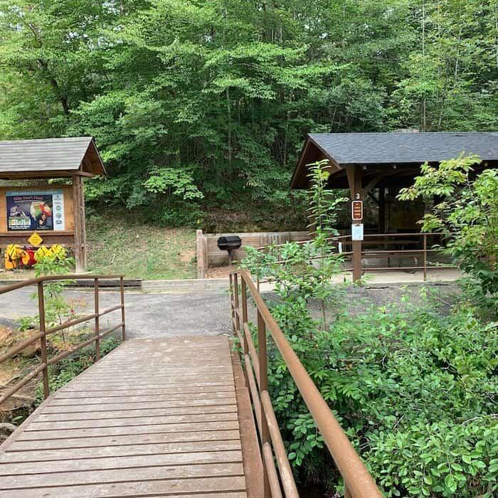 photo of walking bridge and picnic shelter at Chau Ram park