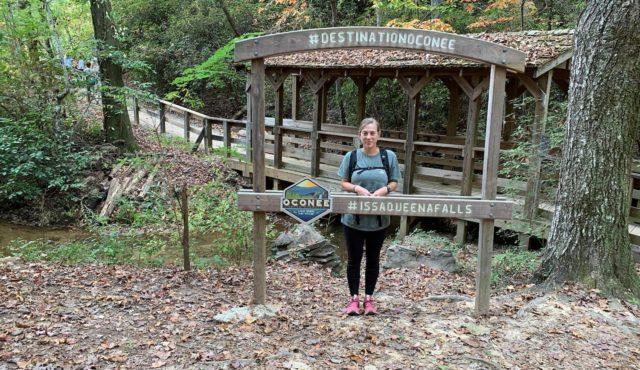 photo of blog author Chanda Morrison by #Destination Oconee sign