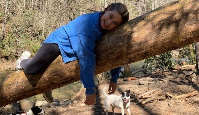 girl resting on tree in Mtn rest, sc