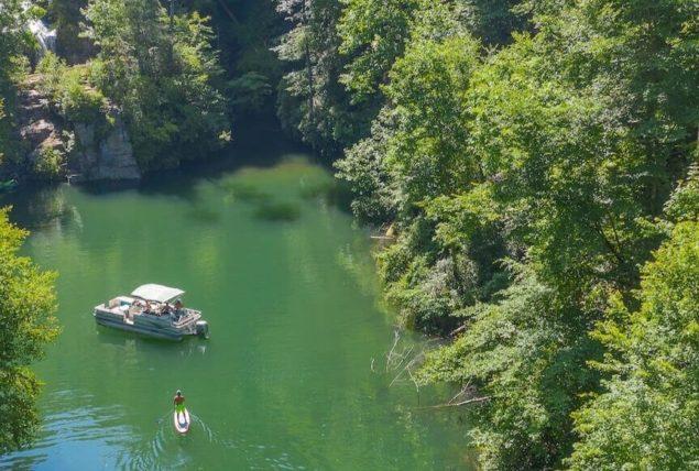 aerial view pontoon boat, SUP on Lake Jocassee