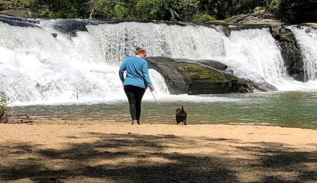 Woman and dog at Riley Moore Falls