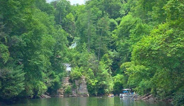 pic of a boat near waterfall on Lake jocassee